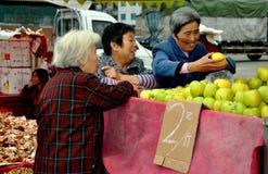 Pengzhou, China: Women Buying Apples Stock Photos