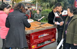 Pengzhou, China: Women Buying Fresh Nuts Royalty Free Stock Photography
