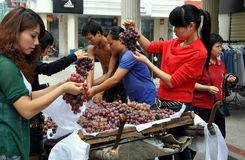 Pengzhou, China: Women Buying Grapes Royalty Free Stock Images