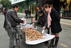 Pengzhou, China: Women Buying Mushrooms Stock Photo
