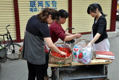 Pengzhou, China: Women Buying Strawberries Stock Images