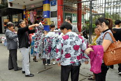 Pengzhou, China: Women Buying Street Clothes Stock Photos