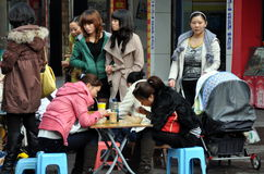 Pengzhou, China: Women Eating & Shopping Stock Photo