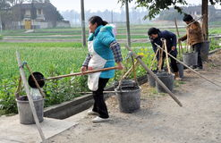 Pengzhou, China: Women Filling Water Buckets Stock Photos