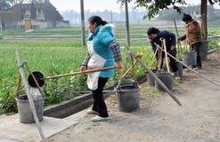 Pengzhou, China: Women Filling Water Buckets Stock Photos
