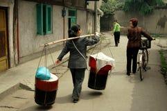 Pengzhou, China: Women on Hua Lu stock photography
