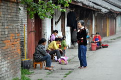 Pengzhou, China: Women on Hua Lu Royalty Free Stock Image