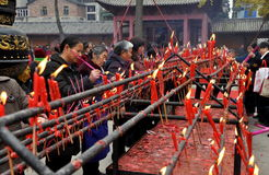 Pengzhou, China: Women Lighting Incense at Temple Royalty Free Stock Photos