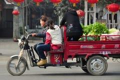 Pengzhou, China: Women in Motorcycle Cart Royalty Free Stock Images