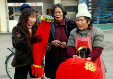 Pengzhou, China:Women with New Year Decorations Royalty Free Stock Photos