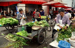 Pengzhou, China: Women Selling Greens at Market Royalty Free Stock Image