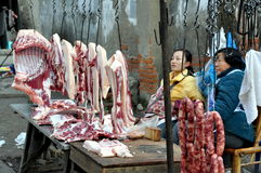 Pengzhou, China: Women Selling Pork Stock Photo