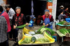 Pengzhou, China: Women Selling Produce Royalty Free Stock Image