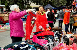 Pengzhou, China: Women Shopping for Clothing Stock Image
