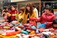 Pengzhou, China: Women Shopping for Wallets Stock Images
