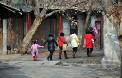 Pengzhou, China: Women Walking on Hua Lu Stock Photos