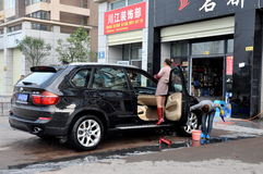 Pengzhou, China: Women Washing Car Royalty Free Stock Photos
