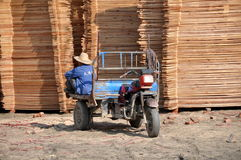 Pengzhou, China: Worker in Lumber Yard Royalty Free Stock Images