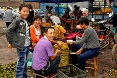 Pengzhou, China: Workers Shelling Walnuts Stock Photography