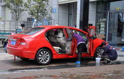 Pengzhou, China: Workers Washing Car Royalty Free Stock Images