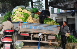 Pengzhou, China: WorkersLoading Truck at Co-op Market Stock Photos