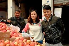 Pengzhou, China: Young Couple Buying Apples Royalty Free Stock Image