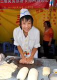 Pengzhou, China: Young Man Kneeding Dough Royalty Free Stock Photos