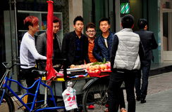 Pengzhou, China: Youths Buying Apples Royalty Free Stock Photography