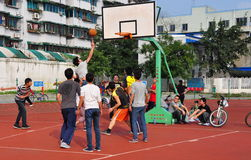 Pengzhou,China: Youths Playing Basketball Royalty Free Stock Image