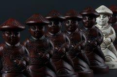 Penhores no grupo de xadrez oriental Fotografia de Stock Royalty Free