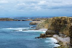 Peniche Coastline, Portugal. Atlantic Ocean Coastline with Cliffs and Harbors on Blue Cloudy Sky background Outdoors. Peniche, Portugal royalty free stock photos