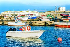 Peniche harbor, fishing boats, docks. Peniche harbor, fishing boats, red buoy, docks in background, Portugal royalty free stock photography