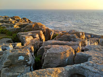 Peniche ocean rocks near Cabo Carvoeiro in sunset light. Portugal stock images