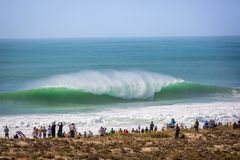 Peniche, Portugal - Oct 18th 2017 - Big crowd of people watching a big wave breaking at the 2017 MEO Rip Curl Pro Portugal in Peni. Che, coast of Portugal royalty free stock images
