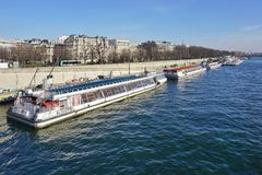 Peniche and tourist boats on the river Seine in Paris Royalty Free Stock Photography