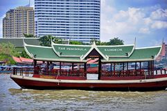 The Peninsula Bangkok shuttle boat cruises on Chao Praya river Stock Photo