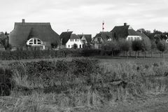 Modern style captain`s houses in black-white with a red-white striped light house in Zingst, Baltic Sea, Germany, Europe stock photo