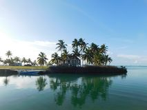 Palm trees in the key islands, Florida. Peninsula in Florida keys, palm trees and boat at the edge of the bank, calm sea, blue sky stock photos