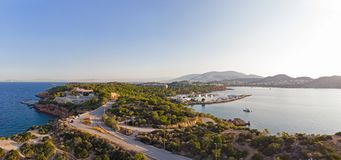 Peninsula of Kavouri, Athens - Greece. View of the Peninsula of Kavouri at Vouliagmeni, Athens - Greece. The peninsula is covered with pine trees and feature stock images