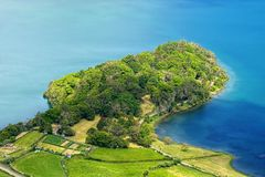 Peninsula of Lagoa Azul lake, Sao Miguel island, Azores, Portugal. Aerial view of green peninsula of Lagoa Azul lake, situated in wide volcanic crater called royalty free stock photos