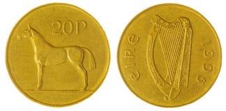 20 peniques 1995 acuñan aislado en el fondo blanco, Irlanda Foto de archivo libre de regalías