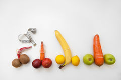 Penis measure. Fruits and vegetables in condoms Royalty Free Stock Images