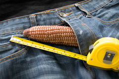 Penis symbol - Corn and measuring tape on jeans Stock Photo
