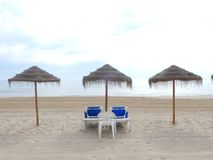 Sunbeds and umbrellas on the beach for relaxation Royalty Free Stock Photography