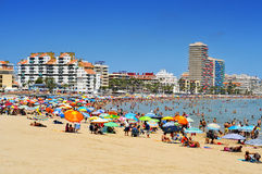 Peniscola, Spain. JULY, 26: Bathers in North Beach on July 26, 2013 in . The town is a typical summer destination facing the Mediterranean Sea, in the North Royalty Free Stock Photos