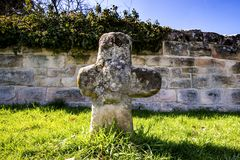 Penitence cross with old medieval abbey wall. In Adelberg, Germany Royalty Free Stock Photo