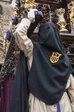 Penitent of the brotherhood of. `Jesus Despojado` next to the float of Christ Stock Images