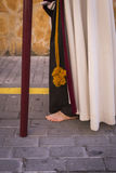 Penitent carried a wooden cross in a procession of Holy week, Se Stock Images