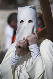 Penitent carried a wooden cross in a procession of Holy week Royalty Free Stock Images