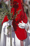 Penitent with a crosier carried olive branches during a procession of holy week on Palm Sunday. Spain Royalty Free Stock Images